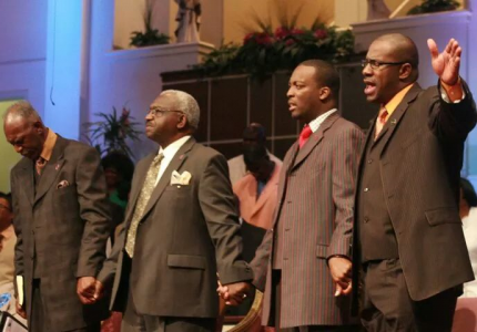 Bishop Cooper, Carr, Apostle Murray Praying
